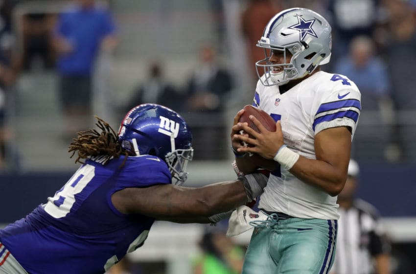 ARLINGTON, TX - SEPTEMBER 11: Dak Prescott #4 of the Dallas Cowboys is hit by Damon Harrison #98 of the New York Giants during the second half at AT&T Stadium on September 11, 2016 in Arlington, Texas. (Photo by Ronald Martinez/Getty Images)