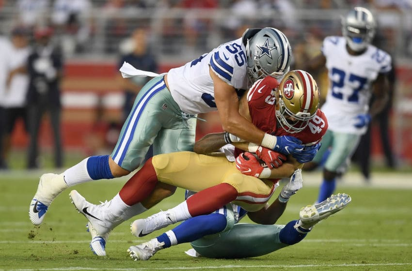 SANTA CLARA, CA - AUGUST 09: Leighton Vander Esch #55 and Justin March-Lillard #53 of the Dallas Cowboys tackles Marcell Harris #49 of the San Francisco 49ers in the second quarter of their NFL preseason football game at Levi's Stadium on August 9, 2018 in Santa Clara, California. (Photo by Thearon W. Henderson/Getty Images)