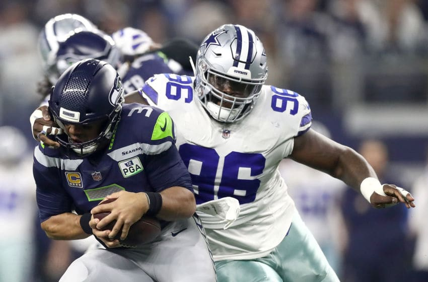 ARLINGTON, TEXAS - JANUARY 05: Russell Wilson #3 of the Seattle Seahawks is sacked by Maliek Collins #96 of the Dallas Cowboys in the first half during the Wild Card Round at AT&T Stadium on January 05, 2019 in Arlington, Texas. (Photo by Ronald Martinez/Getty Images)