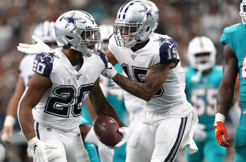 ARLINGTON, TEXAS - SEPTEMBER 22: Tony Pollard #20 of the Dallas Cowboys and Devin Smith #15 of the Dallas Cowboys at AT&T Stadium on September 22, 2019 in Arlington, Texas. (Photo by Ronald Martinez/Getty Images)