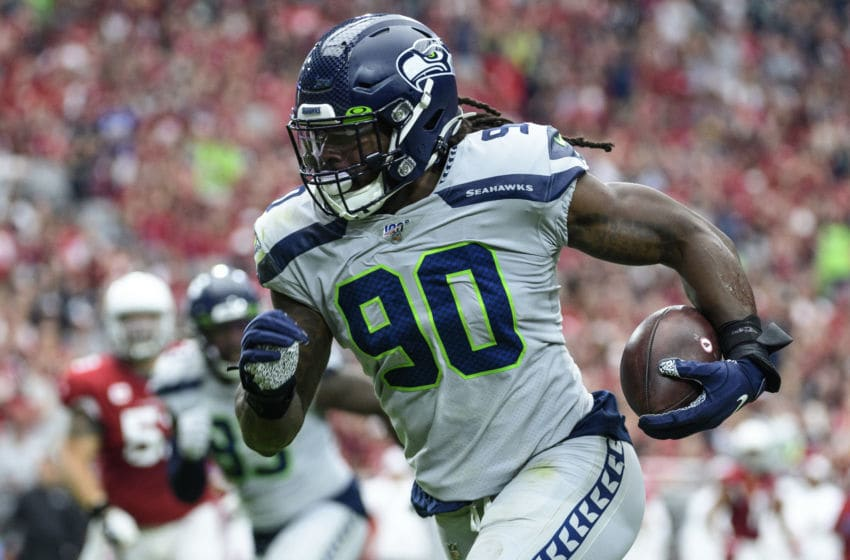 GLENDALE, ARIZONA - SEPTEMBER 29: Outside linebacker Jadeveon Clowney #90 of the Seattle Seahawks run in an interception for a touchdown in the first half of the NFL game against the Arizona Cardinals at State Farm Stadium on September 29, 2019 in Glendale, Arizona. (Photo by Jennifer Stewart/Getty Images)