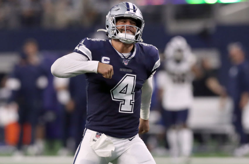 ARLINGTON, TEXAS - DECEMBER 15: Dak Prescott #4 of the Dallas Cowboys celebrates after the Dallas Cowboys score a touchdown against the Los Angeles Rams in the second quarter at AT&T Stadium on December 15, 2019 in Arlington, Texas. (Photo by Tom Pennington/Getty Images)