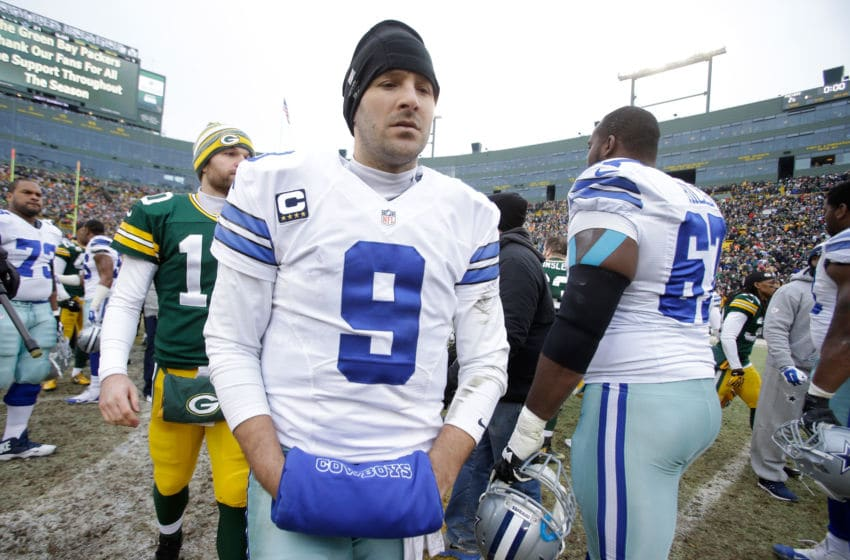 GREEN BAY, WI - JANUARY 11: Quarterback Tony Romo #9 of the Dallas Cowboys walks off the field after the Green Bay Packers won 26-21 during the 2015 NFC Divisional Playoff game at Lambeau Field on January 11, 2015 in Green Bay, Wisconsin. (Photo by Mike McGinnis/Getty Images)