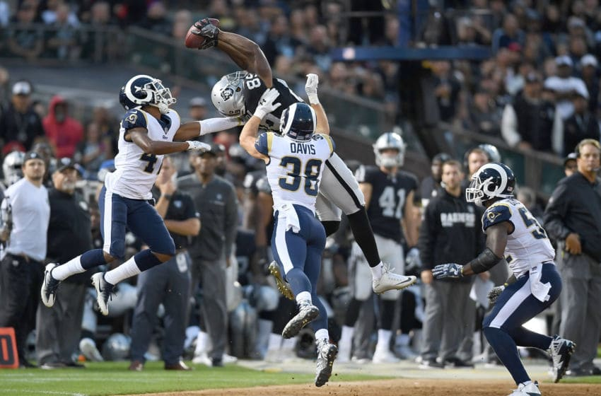 OAKLAND, CA - AUGUST 19: Amari Cooper #89 of the Oakland Raiders catches a thirty one yard pass over Kevin Peterson #47 and Cody Davis #38 of the Los Angeles Rams during the second quarter of their preseason NFL football game at Oakland-Alameda County Coliseum on August 19, 2017 in Oakland, California. (Photo by Thearon W. Henderson/Getty Images)