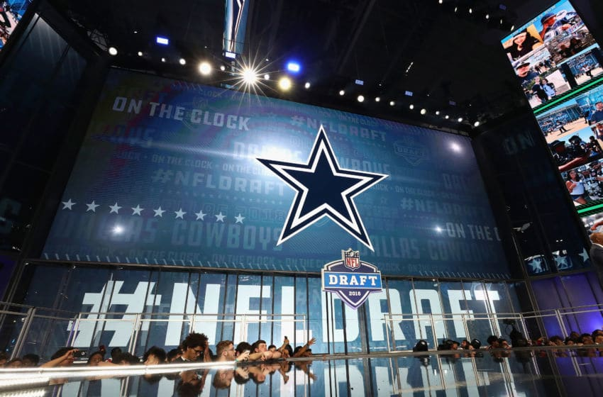 ARLINGTON, TX - APRIL 26: The Dallas Cowboys logo is seen on a video board during the first round of the 2018 NFL Draft at AT&T Stadium on April 26, 2018 in Arlington, Texas. (Photo by Ronald Martinez/Getty Images)