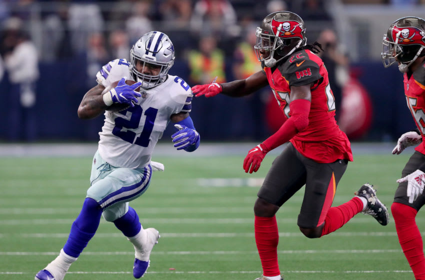 ARLINGTON, TEXAS - DECEMBER 23: Ezekiel Elliott #21 of the Dallas Cowboys carries the ball against De'Vante Harris #22 of the Tampa Bay Buccaneers in the fourth quarter at AT&T Stadium on December 23, 2018 in Arlington, Texas. (Photo by Tom Pennington/Getty Images)