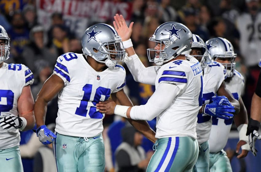 LOS ANGELES, CA - JANUARY 12: Amari Cooper #19 of the Dallas Cowboys celebrates a 29 yard touchdown pass from Dak Prescott #4 in the first quarter against the Los Angeles Rams in the NFC Divisional Playoff game at Los Angeles Memorial Coliseum on January 12, 2019 in Los Angeles, California. (Photo by Harry How/Getty Images)
