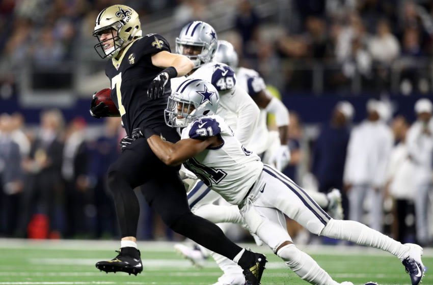 ARLINGTON, TEXAS - NOVEMBER 29: Taysom Hill #7 of the New Orleans Saints is tackled by Byron Jones #31 of the Dallas Cowboys at AT&T Stadium on November 29, 2018 in Arlington, Texas. (Photo by Ronald Martinez/Getty Images)