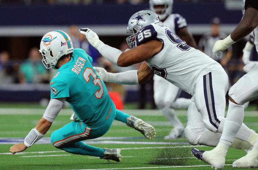 ARLINGTON, TEXAS - SEPTEMBER 22: Josh Rosen #3 of the Miami Dolphins gets hit by Christian Covington #95 of the Dallas Cowboys on the way down in the second quarter at AT&T Stadium on September 22, 2019 in Arlington, Texas. (Photo by Richard Rodriguez/Getty Images)