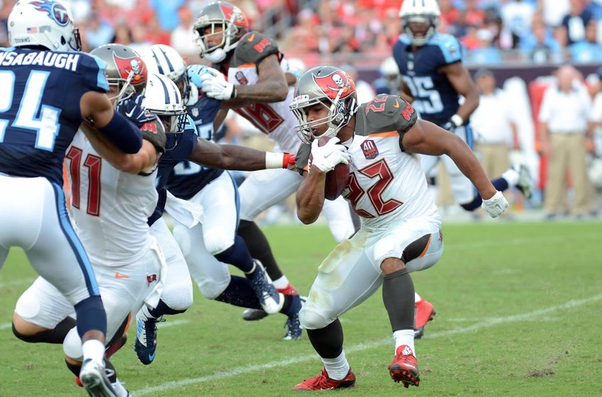 Sep 13, 2015; Tampa, FL, USA; Tampa Bay Buccaneers running back Doug Martin (22) runs the the ball during the second half against the Tennessee Titans at Raymond James Stadium. Mandatory Credit: Jonathan Dyer-USA TODAY Sports