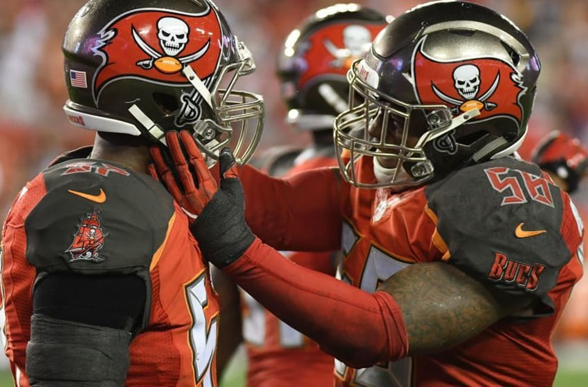 Dec 11, 2016; Tampa, FL, USA; Tampa Bay Buccaneers linebacker Kwon Alexander (58) celebrates with Noah Spence (57) after a stop late in the fourth quarter against the New Orleans Saints at Raymond James Stadium. The Tampa Bay Buccaneers defeated the New Orleans Saints 16-11. Mandatory Credit: Jonathan Dyer-USA TODAY Sports