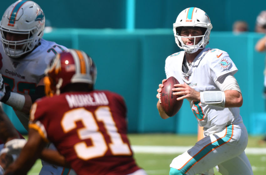 MIAMI, FL - OCTOBER 13: Josh Rosen #3 of the Miami Dolphins rolls out during the first half of the game against the Washington Redskins at Hard Rock Stadium on October 13, 2019 in Miami, Florida. (Photo by Eric Espada/Getty Images)