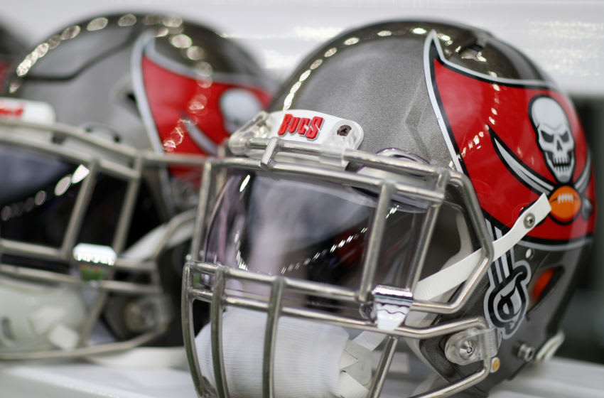 LONDON, ENGLAND - OCTOBER 13: A detailed view of Tampa Bay Buccaneers helmets on the team bench ahead of the NFL game between Carolina Panthers and Tampa Bay Buccaneers at Tottenham Hotspur Stadium on October 13, 2019 in London, England. (Photo by Naomi Baker/Getty Images)