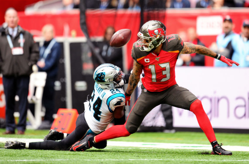 LONDON, ENGLAND - OCTOBER 13: James Bradberry of Carolina Panthers tackles Mike Evans of Tampa Bay Buccaneers during the NFL match between the Carolina Panthers and Tampa Bay Buccaneers at Tottenham Hotspur Stadium on October 13, 2019 in London, England. (Photo by Alex Burstow/Getty Images)