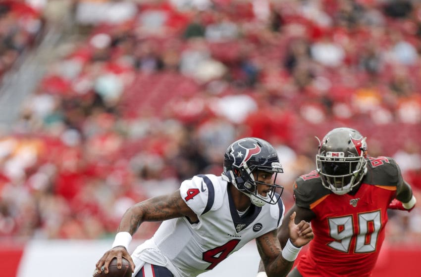 TAMPA, FL - DECEMBER 21: Quarterback Deshaun Watson #4 of the Houston Texans avoids a tackle by Defensive End Jason Pierre-Paul #90 of the Tampa Bay Buccaneers during the game at Raymond James Stadium on December 21, 2019 in Tampa, Florida. The Texans defeated the Buccaneers 23 to 20. (Photo by Don Juan Moore/Getty Images)