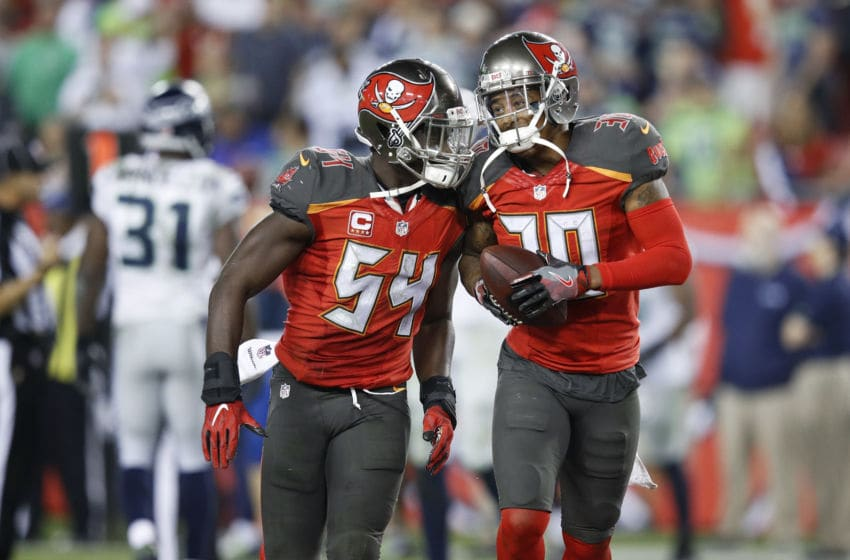 TAMPA, FL - NOVEMBER 27: Bradley McDougald #30 of the Tampa Bay Buccaneers celebrates with Lavonte David #54 after a fourth quarter interception against the Seattle Seahawks during the game at Raymond James Stadium on November 27, 2016 in Tampa, Florida. The Buccaneers defeated the Seahawks 14-5. (Photo by Joe Robbins/Getty Images)