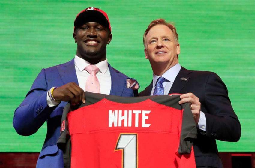 NASHVILLE, TENNESSEE - APRIL 25: Devin White of LSU poses with NFL Commissioner Roger Goodell after being chosen #5 overall by the Tampa Bay Buccaneers during the first round of the 2019 NFL Draft on April 25, 2019 in Nashville, Tennessee. (Photo by Andy Lyons/Getty Images)