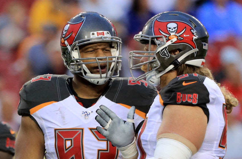 TAMPA, FLORIDA - AUGUST 16: Ndamukong Suh #93 talks with teammate Beau Allen #91 of the Tampa Bay Buccaneers before their preseason game against the Miami Dolphins at Raymond James Stadium on August 16, 2019 in Tampa, Florida. (Photo by Mike Ehrmann/Getty Images)