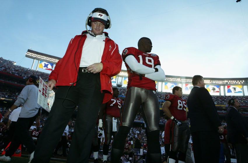 SAN DIEGO - JANUARY 26: Head coach Jon Gruden and wide receiver Keyshawn Johnson #19 of the Tampa Bay Buccaneers stand on the field before the start of Super Bowl XXXVII against the Oakland Raiders at Qualcomm Stadium on January 26, 2003 in San Diego, California. The Buccaneers defeated the Raiders 48-21. (Photo by Al Bello/Getty Images)