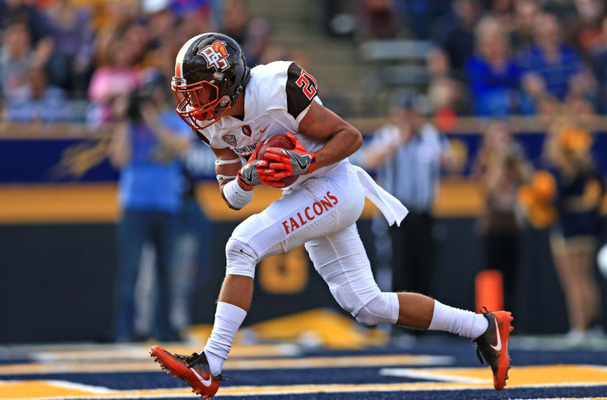 TOLEDO, OH - OCTOBER 15: Bowling Green Falcons wide receiver Scott Miller #21 runs the ball for a touchdown during the first quarter against the Toledo Rockets at Glass Bowl on October 15, 2016 in Toledo, Ohio. (Photo by Andrew Weber/Getty Images)