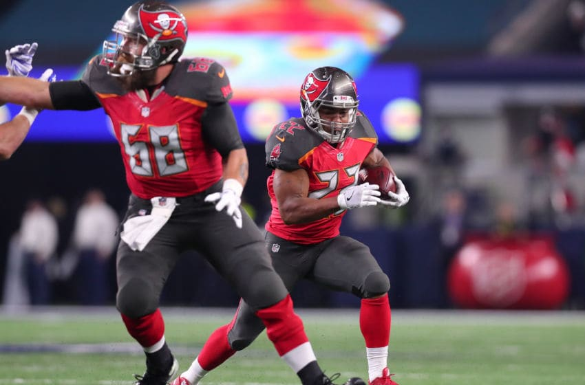 ARLINGTON, TX - DECEMBER 18: Doug Martin #22 of the Tampa Bay Buccaneers carries the ball during the first half against the Dallas Cowboys at AT&T Stadium on December 18, 2016 in Arlington, Texas. (Photo by Tom Pennington/Getty Images)