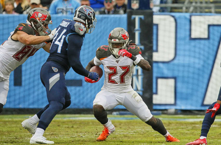 NASHVILLE, TENNESSEE - OCTOBER 27: Ronald Jones #27 of the Tampa Bay Buccaneers carries the ball against Kamalei Correa #44 of the Tennessee Titans during the second half at Nissan Stadium on October 27, 2019 in Nashville, Tennessee. (Photo by Frederick Breedon/Getty Images)