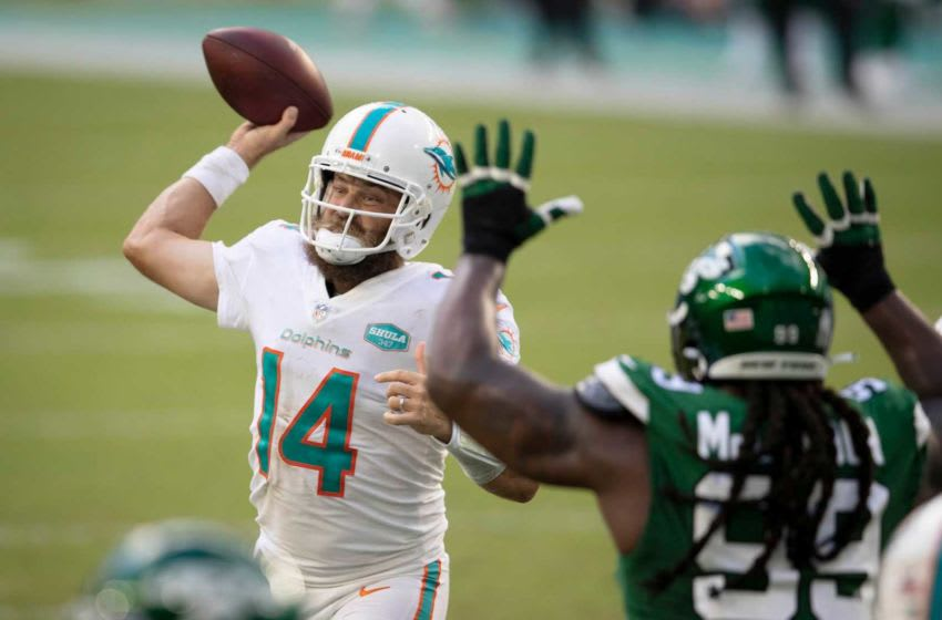 Miami Dolphins quarterback Ryan Fitzpatrick (14) throws a touchdown pass to Miami Dolphins tight end Durham Smythe (81) as New York Jets nose tackle Steve McLendon (99) pressures at Hard Rock Stadium in Miami Gardens, October 18, 2020. [ALLEN EYESTONE/The Palm Beach Post]