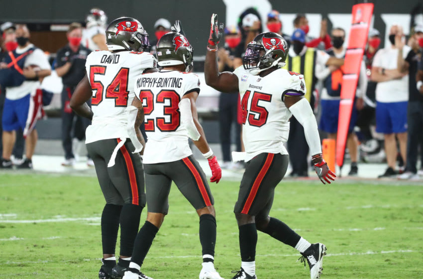Tampa Bay Buccaneers, Devin White, Sean Murphy-Bunting and Lavonte David Mandatory Credit: Kim Klement-USA TODAY Sports