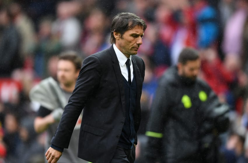 MANCHESTER, ENGLAND - APRIL 16: Antonio Conte, Manager of Chelsea looks dejected after the Premier League match between Manchester United and Chelsea at Old Trafford on April 16, 2017 in Manchester, England. (Photo by Michael Regan/Getty Images)