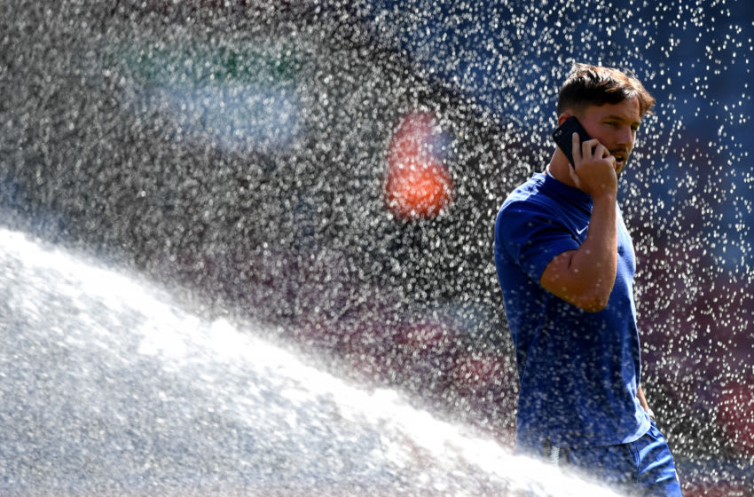 HUDDERSFIELD, ENGLAND - AUGUST 11: Danny Drinkwater of Chelsea speaks on his phone during a pitch inspection prior to the Premier League match between Huddersfield Town and Chelsea FC at John Smith's Stadium on August 11, 2018 in Huddersfield, United Kingdom. (Photo by Shaun Botterill/Getty Images)