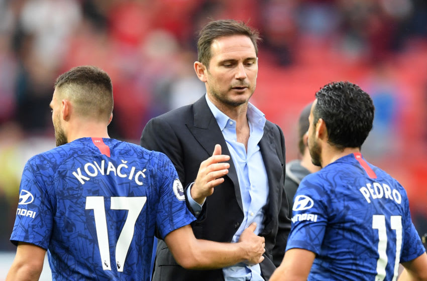MANCHESTER, ENGLAND - AUGUST 11: Frank Lampard, Manager of Chelsea embraces Mateo Kovacic and Pedro of Chelsea after the Premier League match between Manchester United and Chelsea FC at Old Trafford on August 11, 2019 in Manchester, United Kingdom. (Photo by Michael Regan/Getty Images)