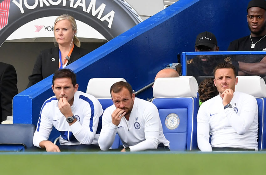 LONDON, ENGLAND - AUGUST 18: Frank Lampard, Manager of Chelsea (L) looks on from the bench with his coaching staff during the Premier League match between Chelsea FC and Leicester City at Stamford Bridge on August 18, 2019 in London, United Kingdom. (Photo by Michael Regan/Getty Images)