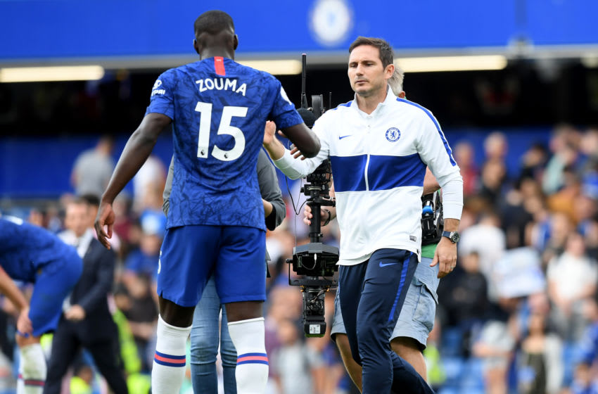 LONDON, ENGLAND - AUGUST 18: Frank Lampard, Manager of Chelsea shakes hands with Kurt Zouma of Chelsea following the Premier League match between Chelsea FC and Leicester City at Stamford Bridge on August 18, 2019 in London, United Kingdom. (Photo by Michael Regan/Getty Images)
