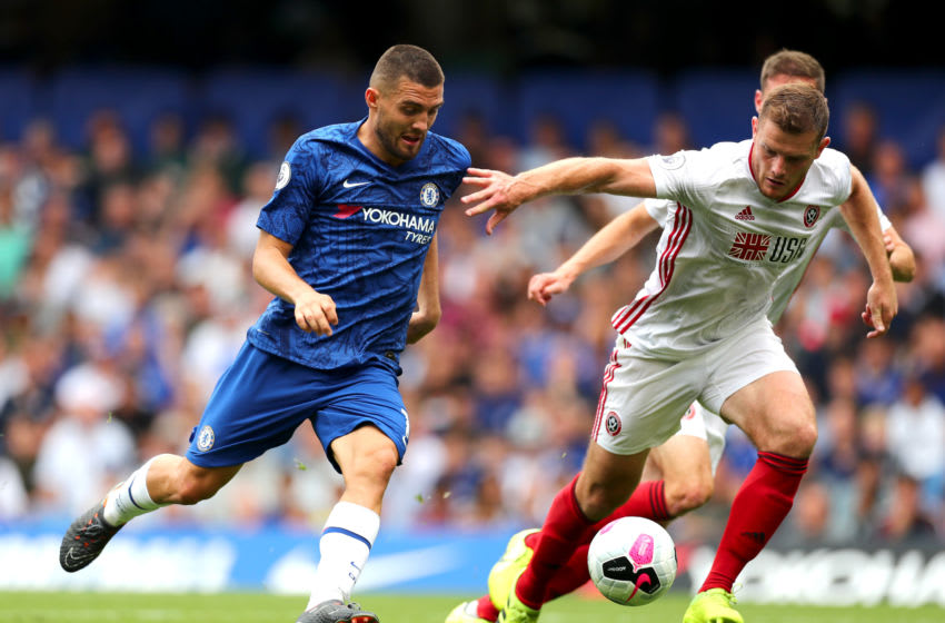 LONDON, ENGLAND - AUGUST 31: Mateo Kovacic of Chelsea is challenged by Jack O'Connell of Sheffield United during the Premier League match between Chelsea FC and Sheffield United at Stamford Bridge on August 31, 2019 in London, United Kingdom. (Photo by Clive Rose/Getty Images)