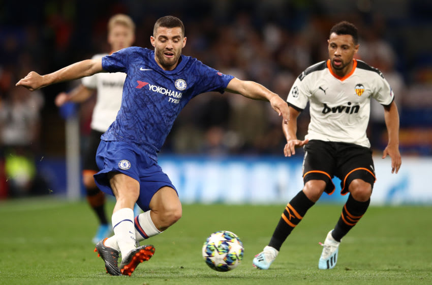 LONDON, ENGLAND - SEPTEMBER 17: Mateo Kovacic of Chelsea is watched by Francis Coquelin of Valencia during the UEFA Champions League group H match between Chelsea FC and Valencia CF at Stamford Bridge on September 17, 2019 in London, United Kingdom. (Photo by Bryn Lennon/Getty Images)