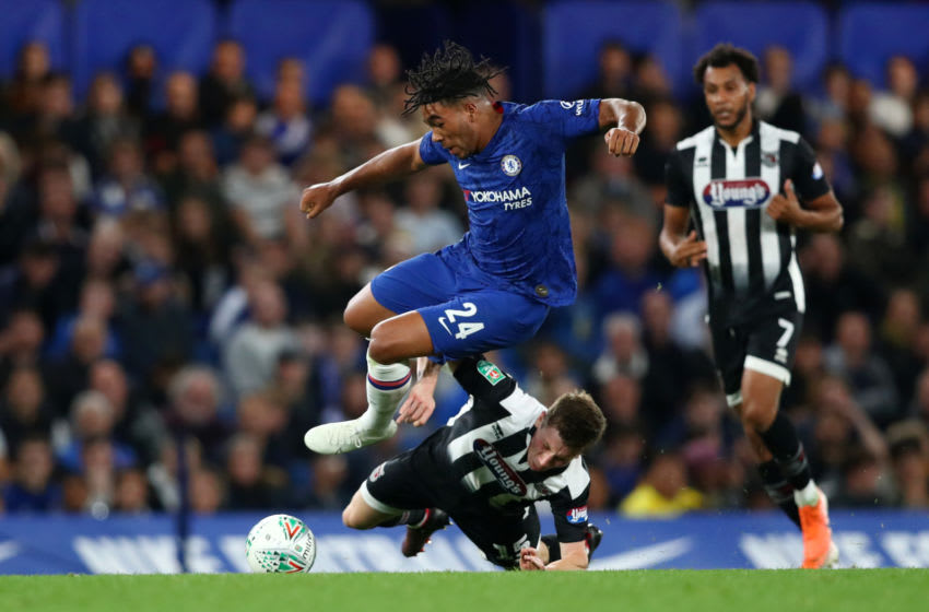 LONDON, ENGLAND - SEPTEMBER 25: Harry Clifton of Grimsby Town tackles Reece James of Chelsea during the Carabao Cup Third Round match between Chelsea FC and Grimsby Town at Stamford Bridge on September 25, 2019 in London, England. (Photo by Dan Istitene/Getty Images)