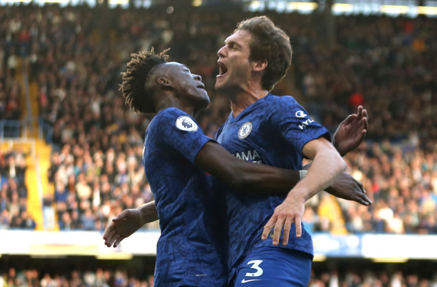 LONDON, ENGLAND - OCTOBER 19: Marcos Alonso of Chelsea celebrates with teammate Tammy Abraham after scoring his team's first goal during the Premier League match between Chelsea FC and Newcastle United at Stamford Bridge on October 19, 2019 in London, United Kingdom. (Photo by Paul Harding/Getty Images)