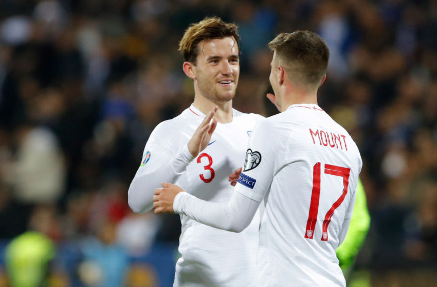 England's midfielder Mason Mount (R) celebrates his goal with his teammate England's defender Benjamin Chilwell during the UEFA Euro 2020 qualifying Group A football match between Kosovo and England at the Fadil Vokrri stadium in Prishtina on November 17, 2019. (Photo by Armend NIMANI / AFP) (Photo by ARMEND NIMANI/AFP via Getty Images)