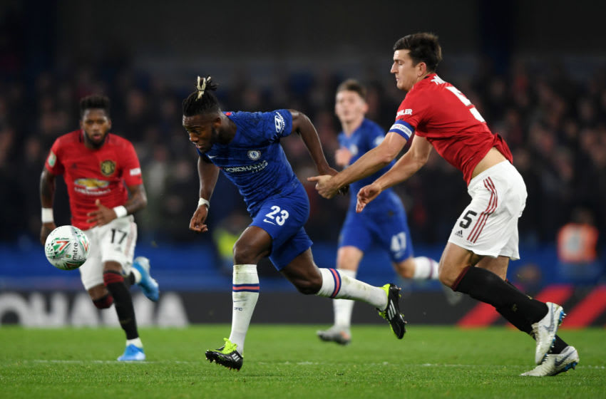 LONDON, ENGLAND - OCTOBER 30: Michy Batshuayi of Chelsea runs with the ball past Harry Maguire of Manchester United before scoring his team's first goal during the Carabao Cup Round of 16 match between Chelsea and Manchester United at Stamford Bridge on October 30, 2019 in London, England. (Photo by Mike Hewitt/Getty Images)