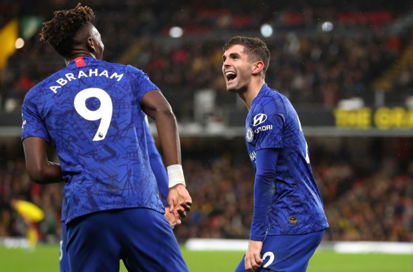WATFORD, ENGLAND - NOVEMBER 02: Christian Pulisic of Chelsea celebrates with teammate Tammy Abraham after scoring his team's second goal during the Premier League match between Watford FC and Chelsea FC at Vicarage Road on November 02, 2019 in Watford, United Kingdom. (Photo by Catherine Ivill/Getty Images)