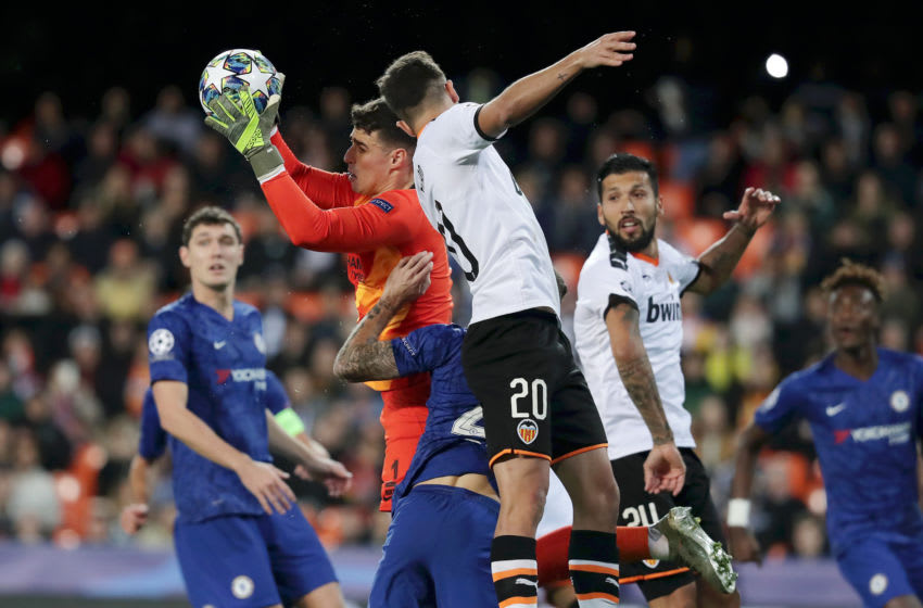 VALENCIA, SPAIN - NOVEMBER 27: Kepa Arrizabalaga of Chelsea catches the ball ahead of Ferran Torres of Valencia during the UEFA Champions League group H match between Valencia CF and Chelsea FC at Estadio Mestalla on November 27, 2019 in Valencia, Spain. (Photo by Gonzalo Arroyo Moreno/Getty Images)