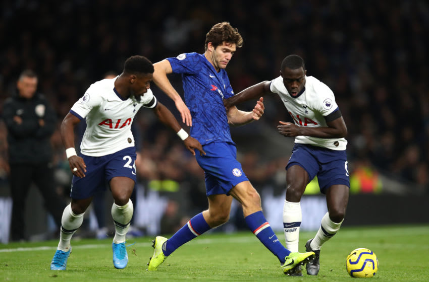 LONDON, ENGLAND - DECEMBER 22: Marcos Alonso of Chelsea is tackled by Davinson Sanchez of Tottenham Hotspur and Serge Aureier of Tottenham Hotspur during the Premier League match between Tottenham Hotspur and Chelsea FC at Tottenham Hotspur Stadium on December 22, 2019 in London, United Kingdom. (Photo by Julian Finney/Getty Images)