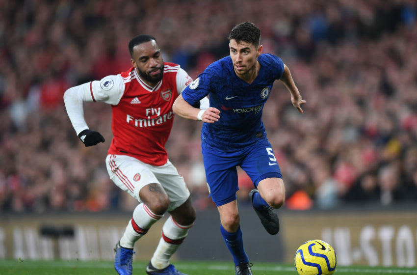 LONDON, ENGLAND - DECEMBER 29: Jorginho of Chelsea is closed down by Alexandre Lacazette of Arsenal during the Premier League match between Arsenal FC and Chelsea FC at Emirates Stadium on December 29, 2019 in London, United Kingdom. (Photo by Shaun Botterill/Getty Images)