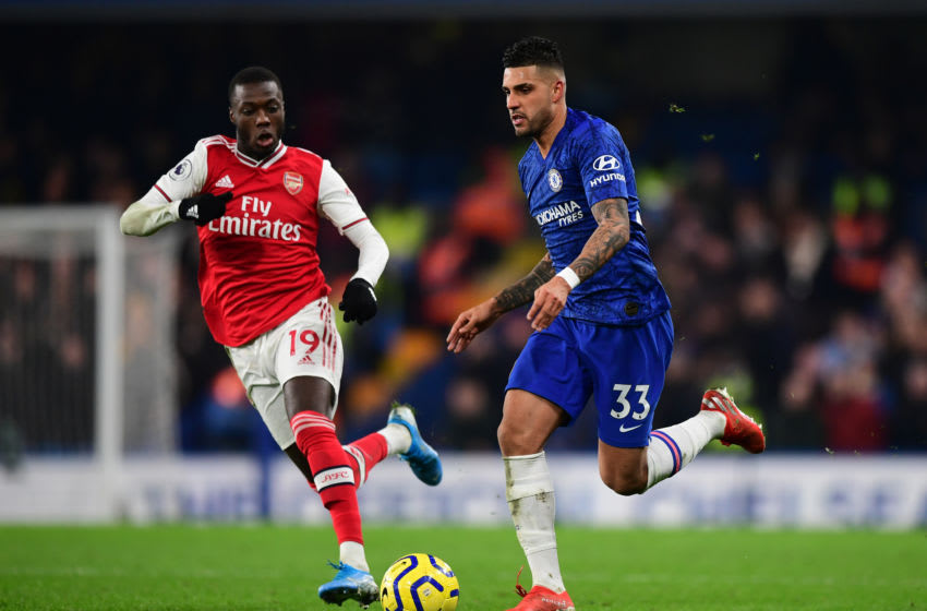 LONDON, ENGLAND - JANUARY 21: Emerson of Chelsea runs with the ball as Nicolas Pepe of Arsenal looks on during the Premier League match between Chelsea FC and Arsenal FC at Stamford Bridge on January 21, 2020 in London, United Kingdom. (Photo by Shaun Botterill/Getty Images)