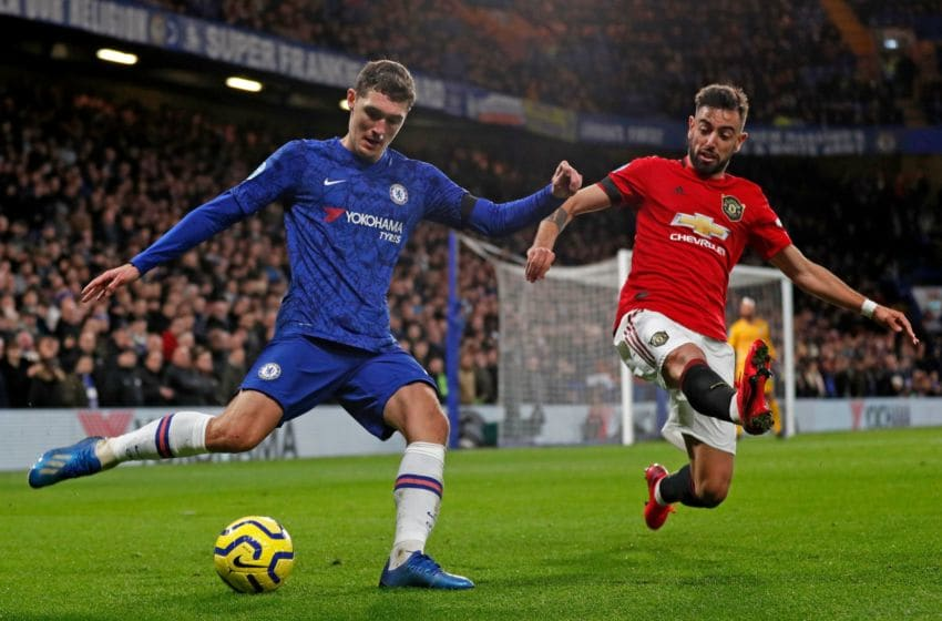 Chelsea's Danish defender Andreas Christensen (L) vies with Manchester United's Portuguese midfielder Bruno Fernandes (R) during the English Premier League football match between Chelsea and Manchester United at Stamford Bridge in London on February 17, 2020. (Photo by Adrian DENNIS / AFP) / RESTRICTED TO EDITORIAL USE. No use with unauthorized audio, video, data, fixture lists, club/league logos or 'live' services. Online in-match use limited to 120 images. An additional 40 images may be used in extra time. No video emulation. Social media in-match use limited to 120 images. An additional 40 images may be used in extra time. No use in betting publications, games or single club/league/player publications. / (Photo by ADRIAN DENNIS/AFP via Getty Images)