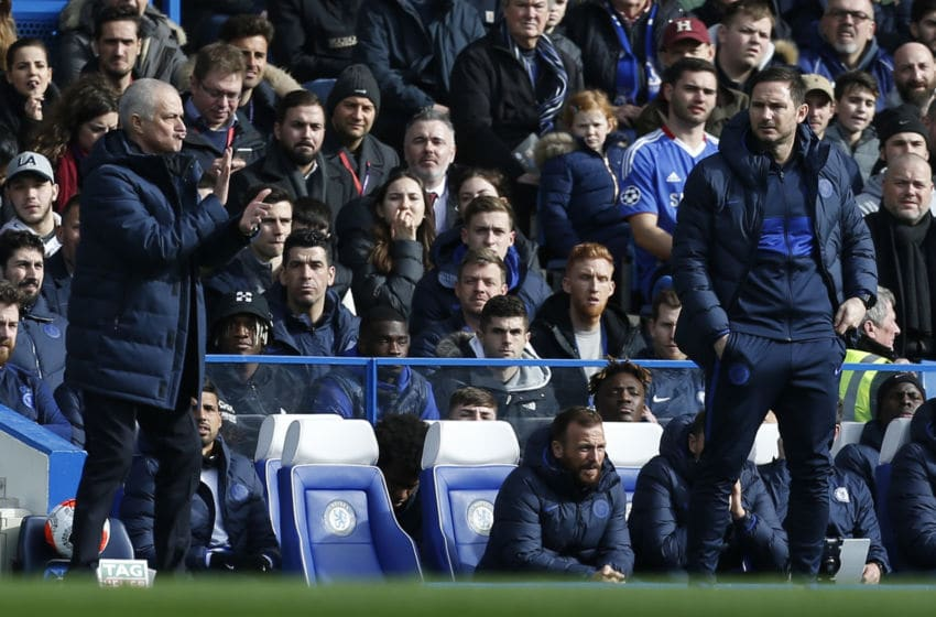 Tottenham Hotspur's Portuguese head coach Jose Mourinho (L) gestures as Chelsea's English head coach Frank Lampard looks on during the English Premier League football match between Chelsea and Tottenham Hotspur at Stamford Bridge in London on February 22 2020. (Photo by Ian KINGTON / AFP) / RESTRICTED TO EDITORIAL USE. No use with unauthorized audio, video, data, fixture lists, club/league logos or 'live' services. Online in-match use limited to 120 images. An additional 40 images may be used in extra time. No video emulation. Social media in-match use limited to 120 images. An additional 40 images may be used in extra time. No use in betting publications, games or single club/league/player publications. / (Photo by IAN KINGTON/AFP via Getty Images)