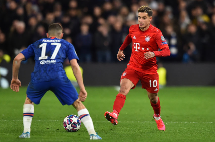 Bayern Munich's Brazilian midfielder Philippe Coutinho (R) passes the ball during the UEFA Champion's League round of 16 first leg football match between Chelsea and Bayern Munich at Stamford Bridge in London on February 25, 2020. (Photo by Glyn KIRK / AFP) (Photo by GLYN KIRK/AFP via Getty Images)