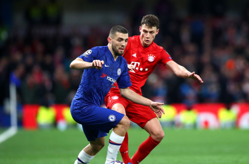 LONDON, ENGLAND - FEBRUARY 25: Mateo Kovacic of Chelsea FC and Benjamin Pavard of FC Bayern Munich in action during the UEFA Champions League round of 16 first leg match between Chelsea FC and FC Bayern Muenchen at Stamford Bridge on February 25, 2020 in London, United Kingdom. (Photo by Chloe Knott - Danehouse/Getty Images)