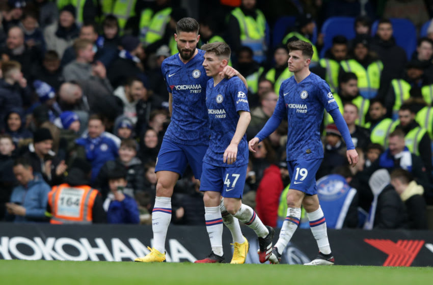 LONDON, ENGLAND - MARCH 08: Olivier Giroud with Billy Gilmour and Mason Mount of Chelsea during the Premier League match between Chelsea FC and Everton FC at Stamford Bridge on March 08, 2020 in London, United Kingdom. (Photo by Robin Jones/Getty Images)
