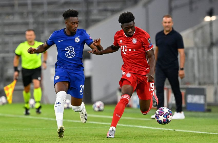 Bayern Munich's Canadian midfielder Alphonso Davies (R) fights for the ball with Chelsea's English midfielder Callum Hudson-Odoi during the UEFA Champions League, second-leg round of 16, football match FC Bayern Munich v FC Chelsea in Munich, southern Germany on August 8, 2020. (Photo by Tobias SCHWARZ / AFP) (Photo by TOBIAS SCHWARZ/AFP via Getty Images)